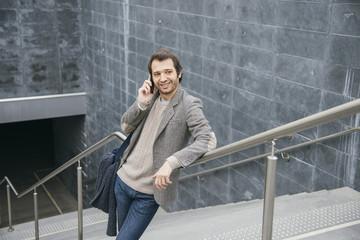 man smartphone smiling