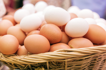 Basket with eggs on market