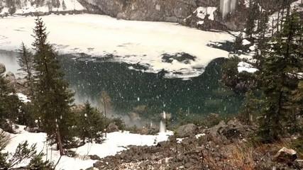 Falling snow near Crno Jezero (Black lake) in Slovenia