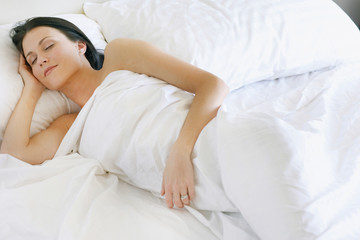 woman linen in bed at home