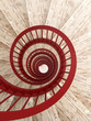 Spiral stairs with red balustrade - 79895082