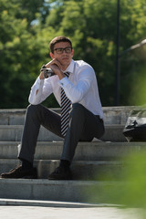 Businessman resting outdoors