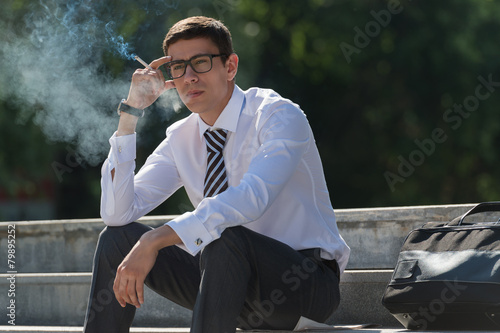 Business man smoking - 79895252