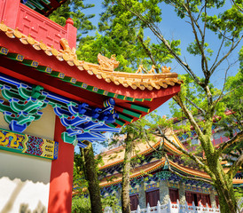 Closeup view of gilded red wooden roofs in traditional Chinese-s