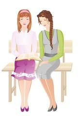 Two girls reading Bible