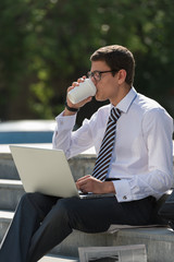 Man with laptop and coffee
