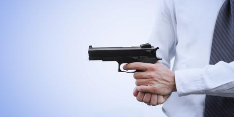Businessman with a gun