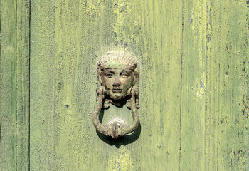 old green door, iron knocker