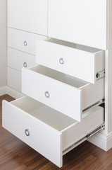 white empty drawer with round stainless handle
