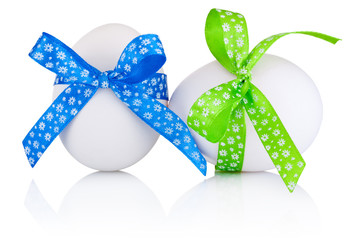 Two Easter eggs with festive bow isolated on white background