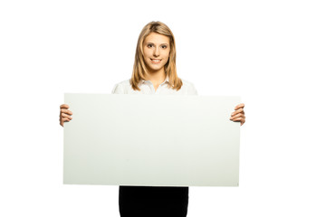 Portrait of a beautiful woman holding a blank billboard