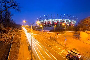 Street in Warsaw at night with National Stadium, Poland