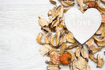 Wooden heart with the word love written