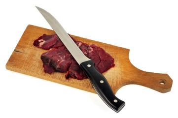 Steak de bœuf sur une planche à découper