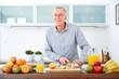 Mature man in the kitchen prepare fruits for breakfast. VI