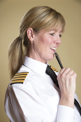 Female airline pilot holding a pen