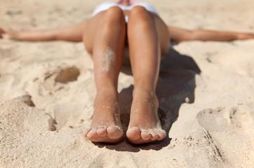 Feet with the sand on beach
