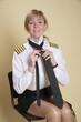 Female airline pilot tying a black necktie