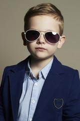 little boy in sunglasses.stylish kid in suit