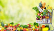 Shopping cart with vegetables and fruits. - 79903870