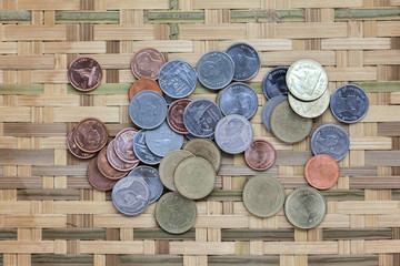 Thai Coins on the bamboo floor from top