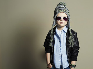 fashionable little boy in sunglasses.stylish child in hat