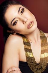 Pretty girl with bijouterie. Fashion photo.