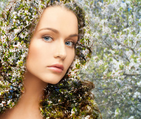 young woman over blooming tree pattern