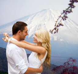 happy couple hugging over japan mountains