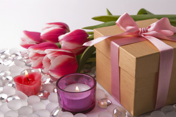 Gift, candles and tulips