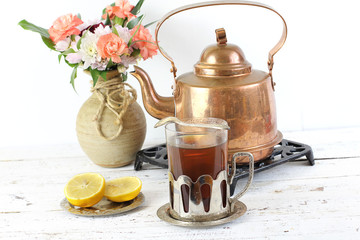 Kettle and glass of tea