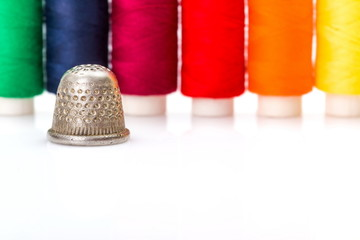 Colorful sewing threads and thimble