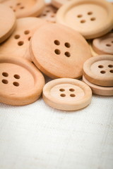 Wooden buttons on fabric
