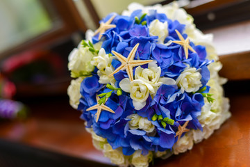 Bridal Bouquet in blue and white decorated with starfish