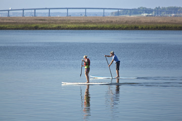 couple stand up paddleboarding