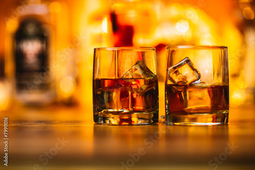 Whiskey drinks on wood - 79911016