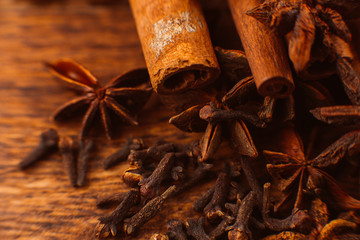 Cinnamon sticks with anise star on wooden background