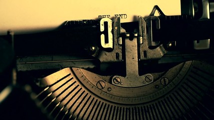 Writing THE END on old typewriter, slowmotion