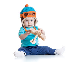 baby boy pilot and with wooden airplane toy