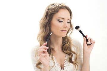 Beautiful woman and make-up brushes