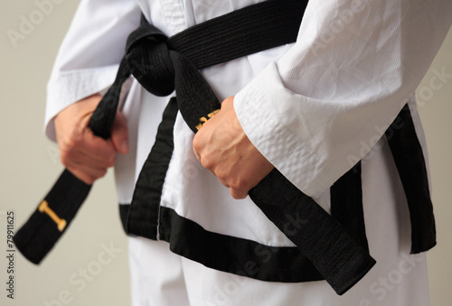 Aluminium Vechtsporten Taekwon-do woman with black belt.