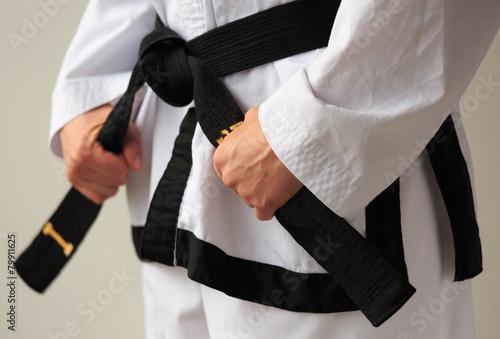 Taekwon-do woman with black belt. - 79911625
