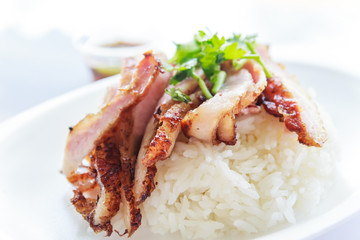 Grill pork with rice and spicy sauce