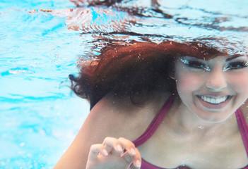 Underwater woman close up portrait