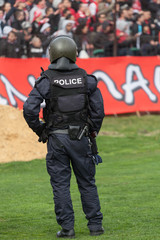 Police officer control fans to prevent football violence