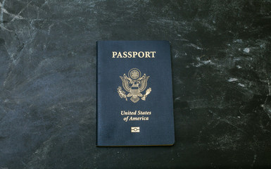 American passport on black background