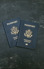 Two US passports on black background