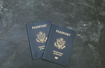 American passports on black background