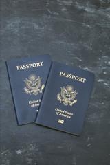 US passports on black background