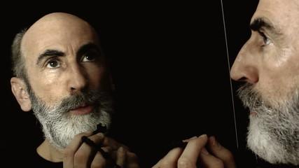Bearded old man mirror praying enlightened